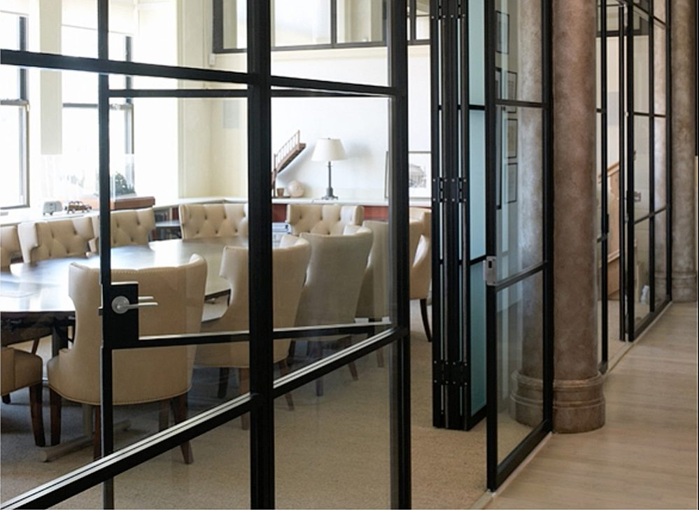 Pk 30 light and dark framed glass wall system by for Retractable walls residential