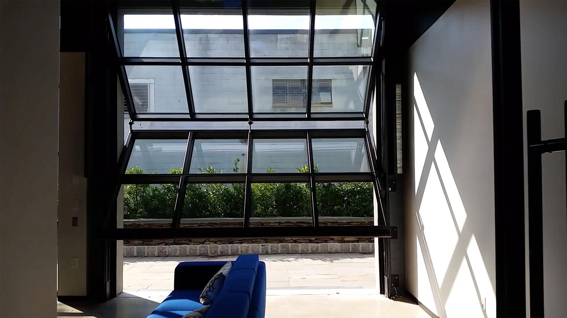 Renlita vertical folding hangar door
