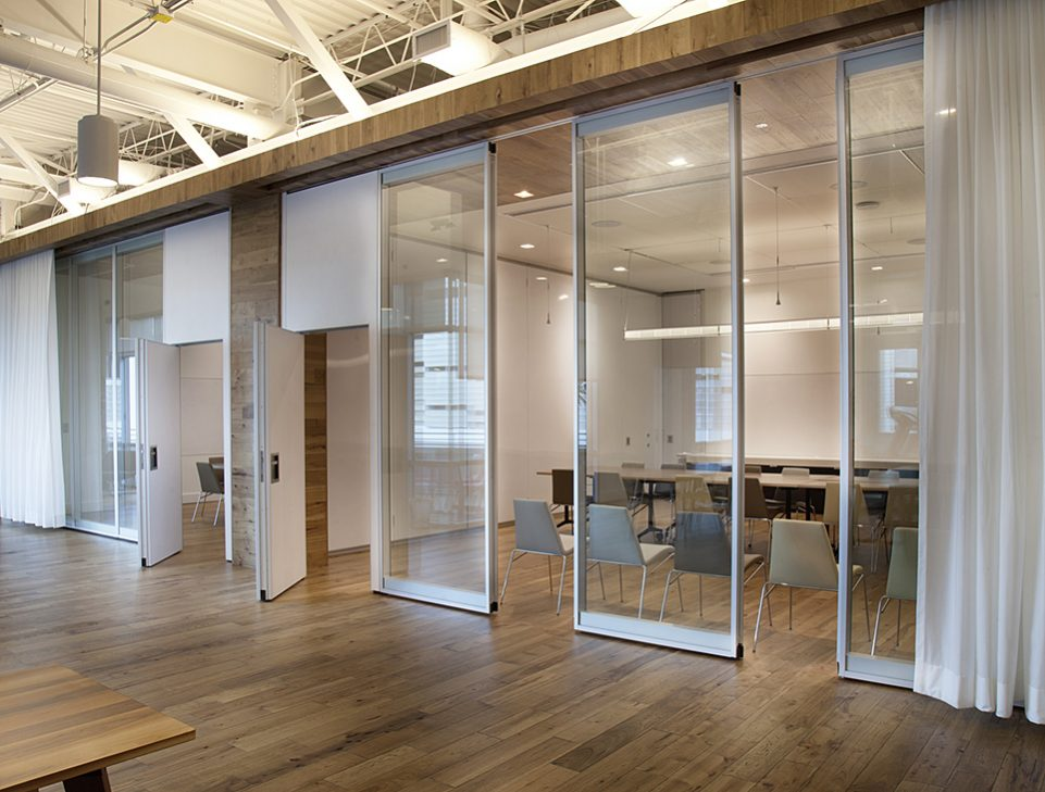 ACOUSTI-CLEAR MOTORIZED GLASS WALLS